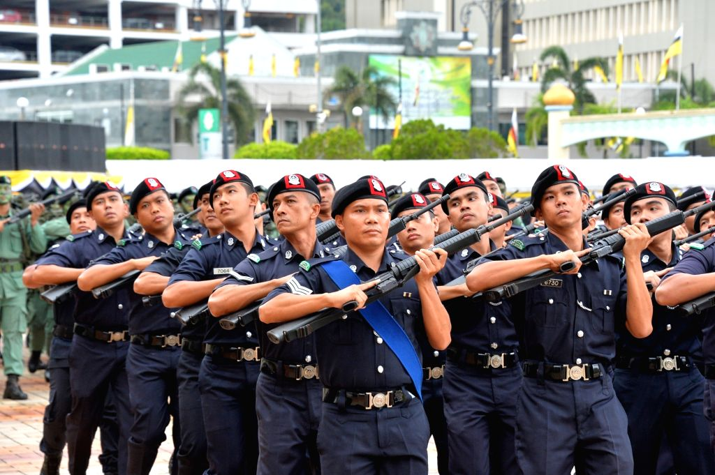 Members of Royal Brunei Police Force take part in the 35th National Day celebration in Bandar Seri Begawan, capital of Brunei, Feb. 23, 2019. Brunei ...