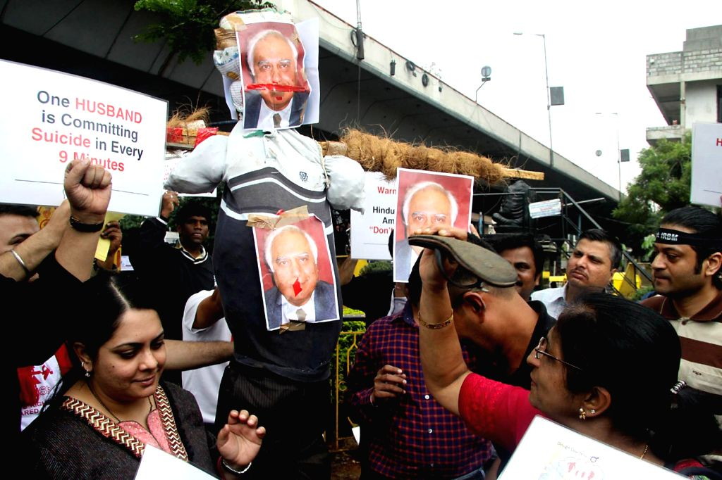 Members of Save Indian Family, Karnataka protesting against Kapil Sibal, Union Minister and demanded to rollback the Marriage Law bill, 2010 from Loksabha in Bangalore on August 31, 2013.