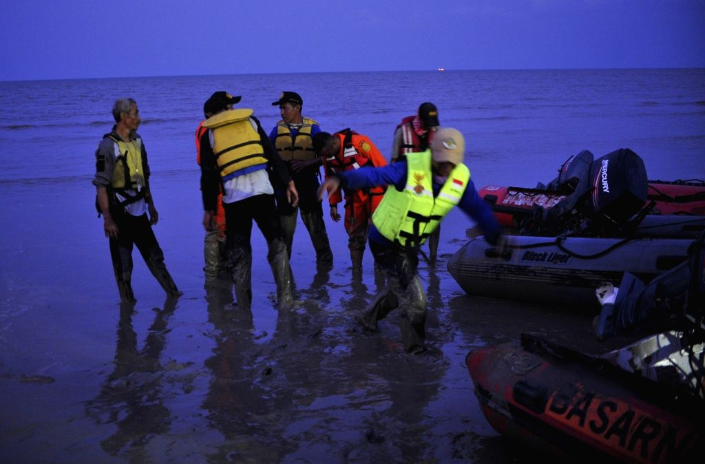 : Members of Search and Rescue team gather after searching at Tanjung Pakis Beach in Karawang, West Java Province, Indonesia, Oct. 29, 2018. Indonesia's ...
