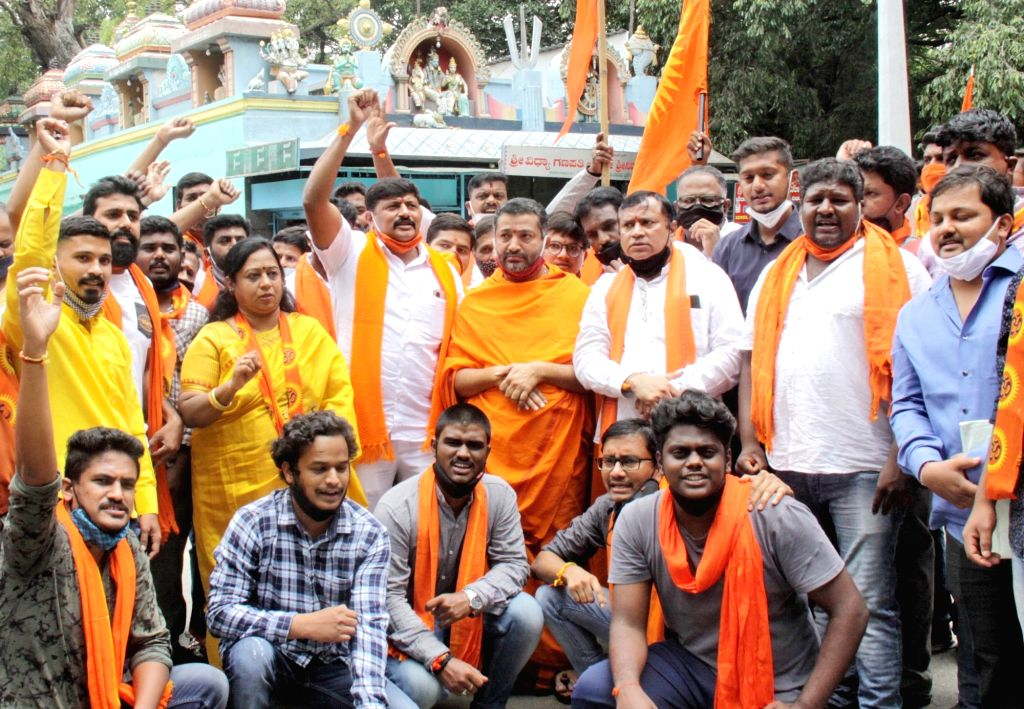 Members of Sri Rama Sena raise slogans during a protest demanding ban of Social Democratic Party of India (SDPI) and People's Front of India (PFI) for their alleged role in the recent ...