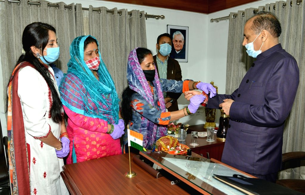 Members of State BJP Mahila Morcha led by its President Rashmi Dhar Sood tie Rakhis on the wrist of Himachal Pradesh Chief Minister Jai Ram Thakur on the occasion of ???Raksha Bandhan??? at ... - Jai Ram Thakur