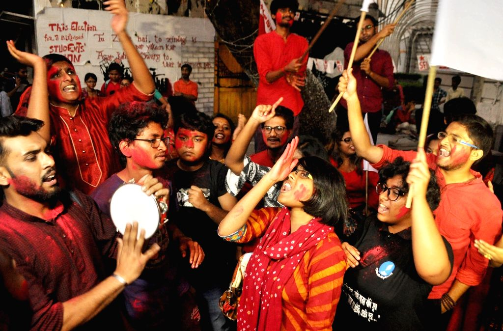 Members of Students Federation of India (SFI), affiliated to CPI-M, celebrate after it swept the elections to the Students Council at Presidency University, in Kolkata on Nov 15, 2019.