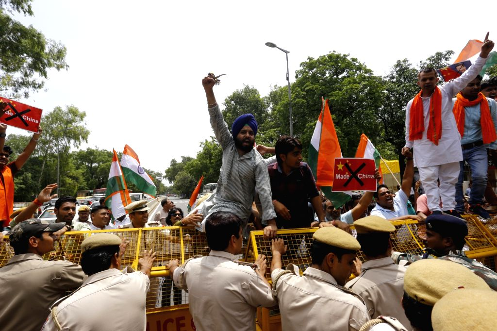 Members of Swadeshi Jagran Manch stage a protest demanding the boycott of Chinese products in front of the Chinese Embassy in New Delhi on July 4, 2017.