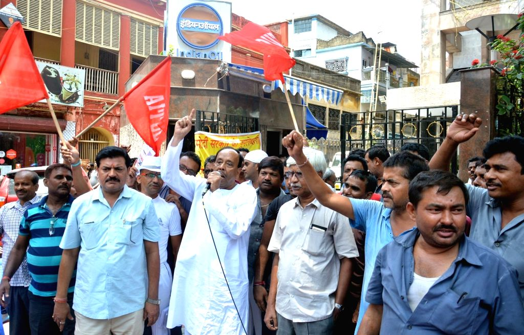 Members of Taxi Operator Union stage a demonstration against hike in the prices of petrol and diesel at the regional office of Indian Oil Corporation Ltd, in Kolkata on May 29, 2018.