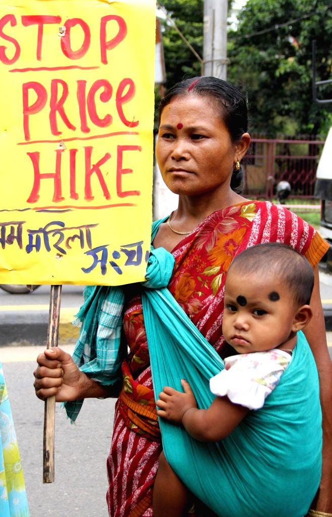 Members of the Asom Mahila Sangha (AMS) taking out a rally protesting against abnormal price rise of essential commodities, demanding to Pass food security bill with amendment, STOP Trafficking and ..