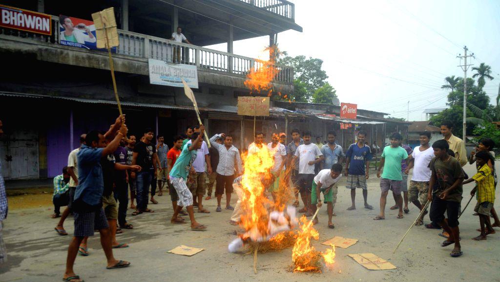 Members of the Bengali Yuva Kaylan Parisad demonstrate against Assam Chief Minister Tarun Gogoi at Patharughat in Assam's Kokrajhar district on Aug 22, 2014. - Tarun Gogoi