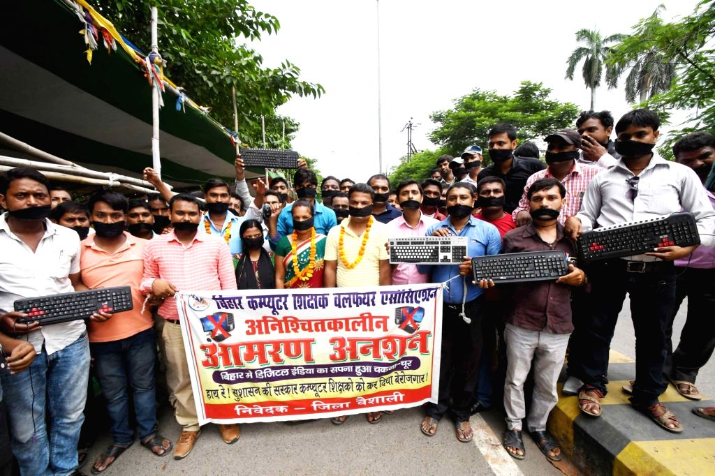 Members of the Bihar Computer Teacher's Welfare Association (BCTWA) stage a demonstration to press for their various demands in Patna on Sept 12, 2017.