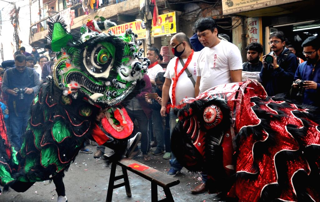 Members of the Chinese community participate in 'Dragon Dance' during Chinese New Year celebrations, in Kolkata on Jan 25, 2020.