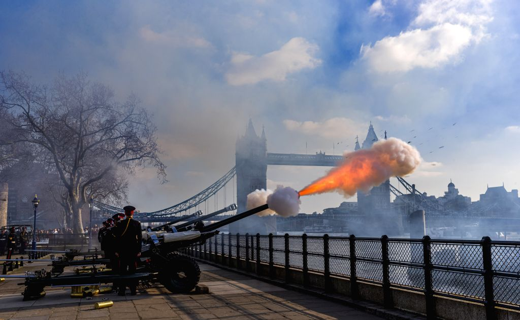 Members of the Honourable Artillery Company fire a 62-round royal gun salute from outside the Tower of London to mark Queen Elizabeth II's 68th anniversary of her ...