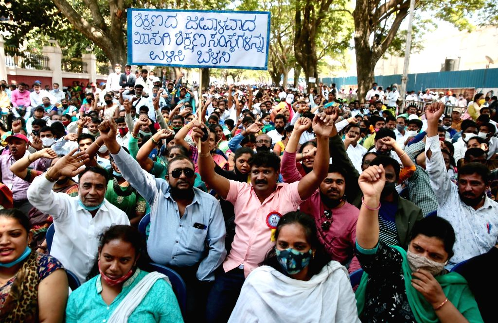 Members of the Karnataka Private School Managements, Teaching and Non-Teaching Staff Coordination Committee (KPMTCC) take part in a protest rally against the state governments order for private ...
