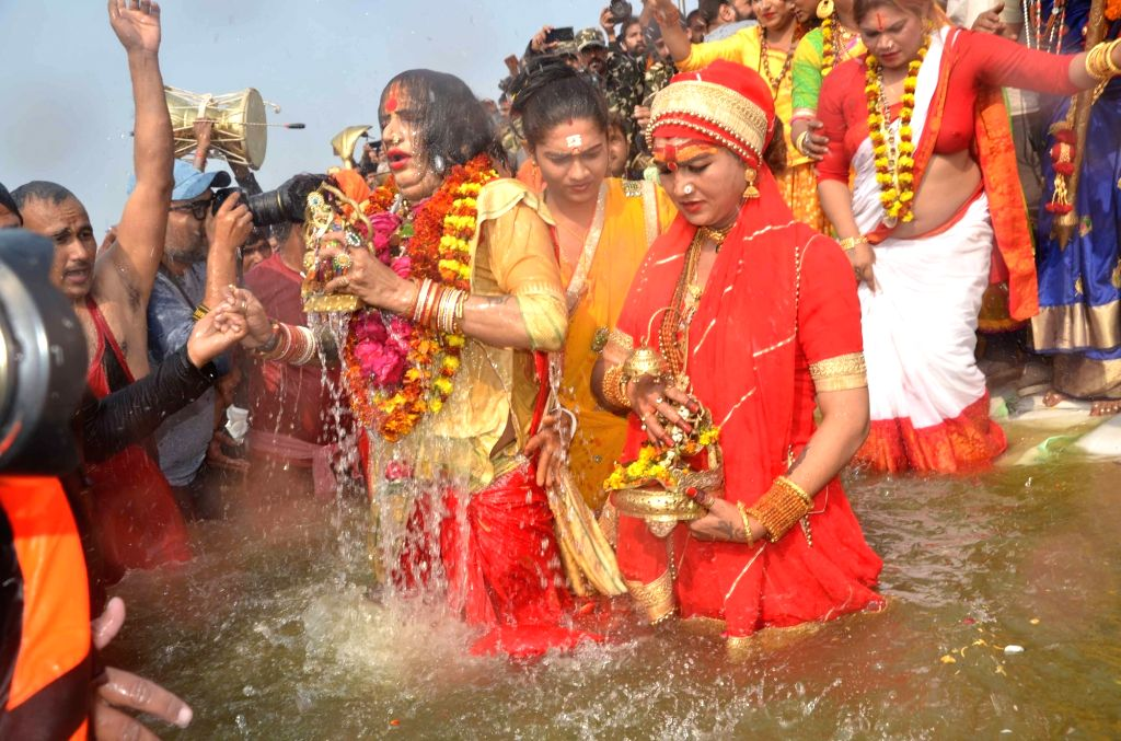 Members of the Kinnar Akhara led by its chief Laxmi Narayan Tripathi, take a holy dip in Sangam - the trinity of rivers Ganga, Yamuna and the mythical Saraswati - on the occasion of 'Mauni ... - Laxmi Narayan Tripathi