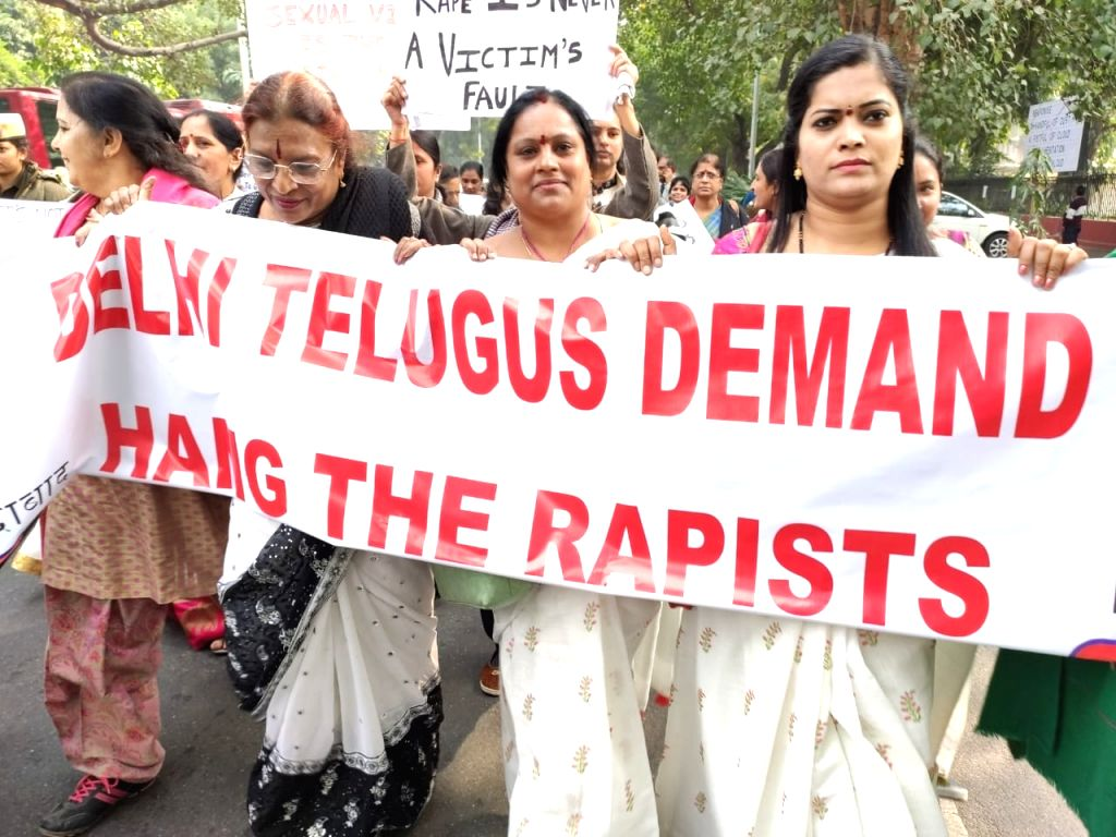 Members of the local Telugu community participate in a pre-scheduled protest march demanding death for the accused in the rape and murder of a young veterinarian in Hyderabad; at the Andhra Bhavan in New Delhi last week. But the apparent execution in