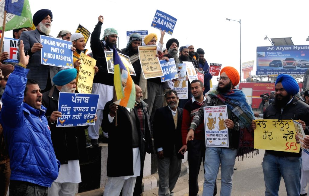 Members of the Muslim community and Dal Khalsa activists stage a demonstration against the Citizenship Amendment Act (CAA) 2019 and National Register of Citizens (NRC), in Amritsar on Jan ...