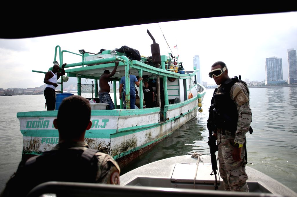 Members of the National Aeronaval Service (SENAN) take part in a routine security operation in Panama Bay, Panama City, capital of Panama, on Aug. 18, 2015. The ...