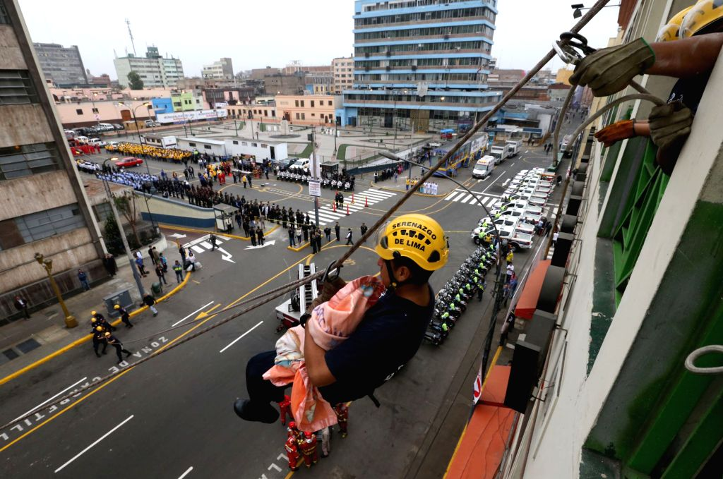 Members of the National Police of Peru (PNP) and the General Corps of Volunteer Firefighters of Peru (CGBVP) of Lima's Metropolitan Municipality, participate in the ...
