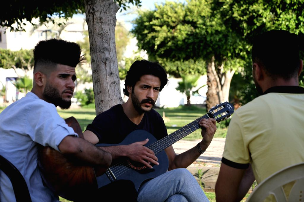 "Members of the Palestinian band ""Street Band"" perform at a park in Gaza City, on June 24, 2020. Every day, just before sunset, three Palestinian youths from ..."