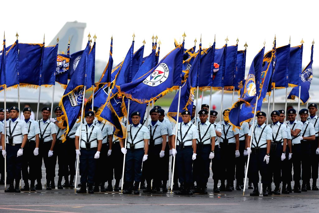 Members of the Philippine Air Force (PAF) stand during the 70th anniversary of the PAF at Clark Air Base in Pampanga Province, the Philippines, July 4, ...