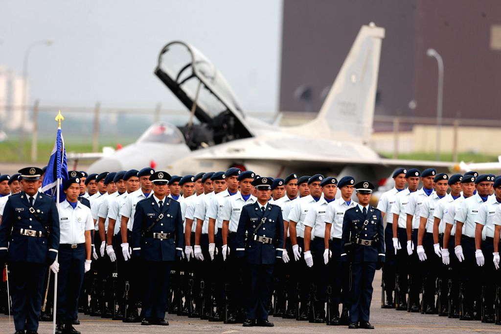 Members of the Philippine Air Force (PAF) stand in formation during the 70th anniversary of the PAF at Clark Air Base in Pampanga Province, the ...