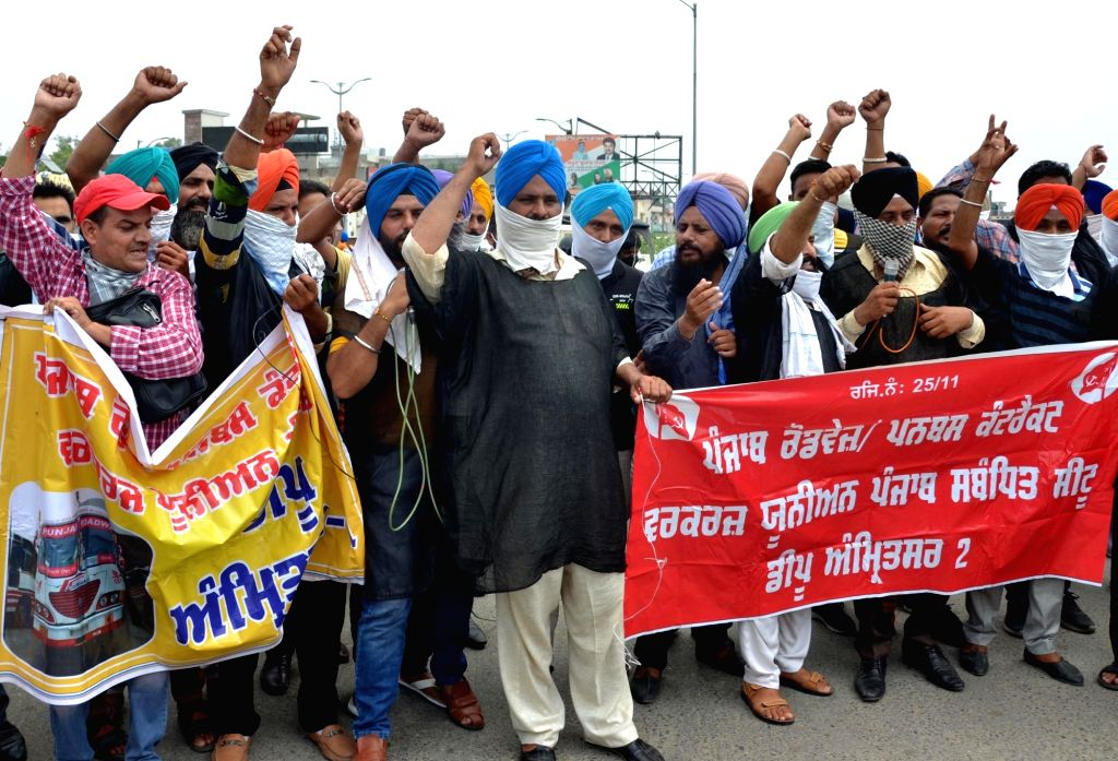 Members of the Punjab Roadways Punbus Contract Union protest against the State Government over the deduction of their salaries, in Amritsar on Aug 13, 2020.