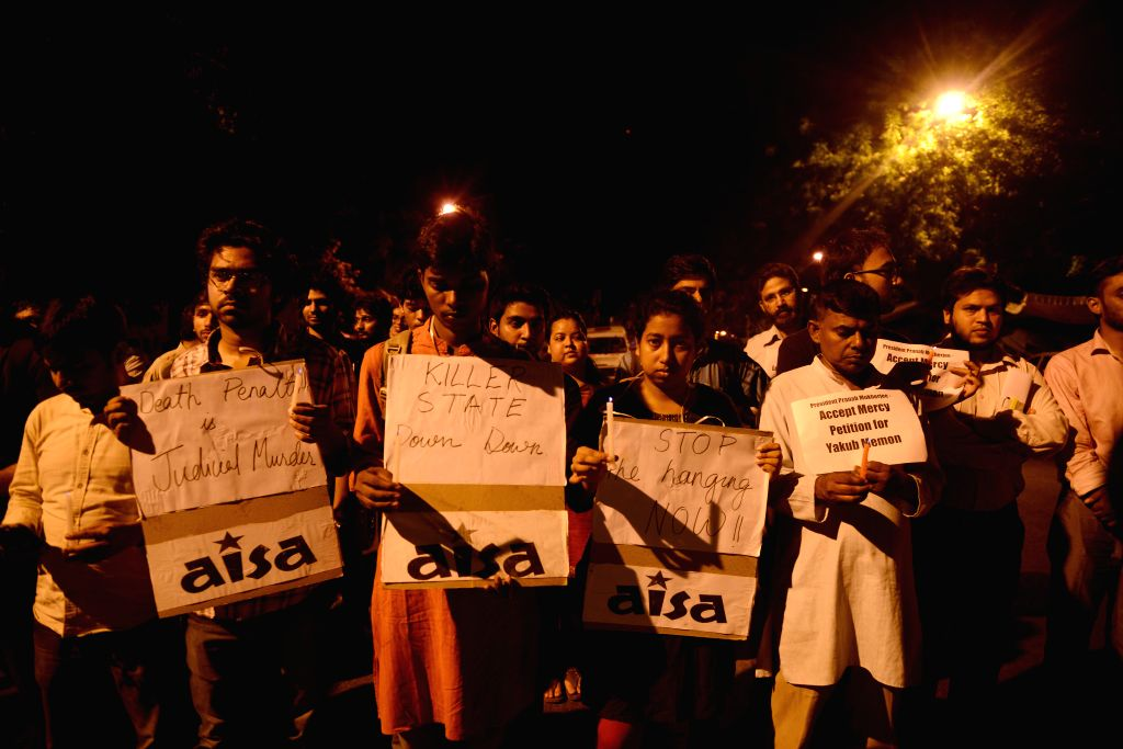 Members of the Social Democratic Party of India (SDPI) and AISA holding a candle light protest against excution of Mumbai 1993 serial blasts convict Yakub Memon, in New Delhi, on July 29, ...