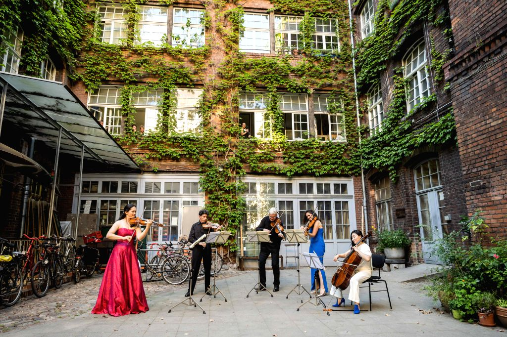 Members of the Staatskapelle Berlin orchestra perform during a backyard concert in Berlin, capital of Germany, on June 23, 2020.