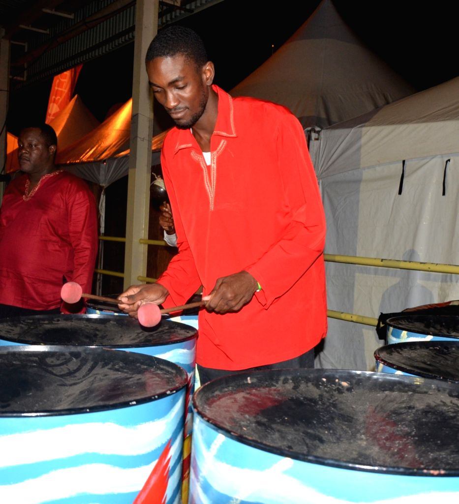 Members of the T&TEC Nada Sangama Steel Orchestra perform during the inauguration of National Council of Indian Culture's (NCIC) 29th annual Divali Nagar celebrations in Chaguanas, Trinidad and ...