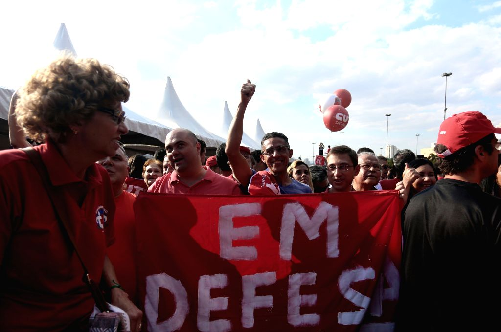 Members of unions, social movements and of the Worker's Party (PT, for its acronym in Spanish), take part in a demonstration supporting Brazilian President Dilma ...