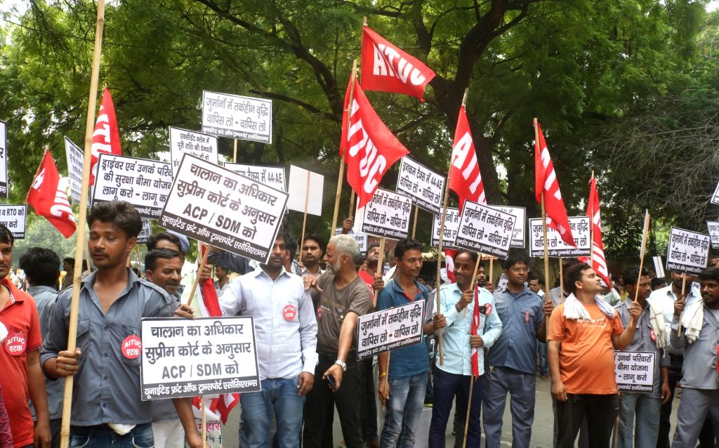 Members of United Front of Transport Associations (UFTA) stage a demonstration against hefty traffic penalties imposed under the new Motor Vehicles Act, in New Delhi on Sep 16, 2019.
