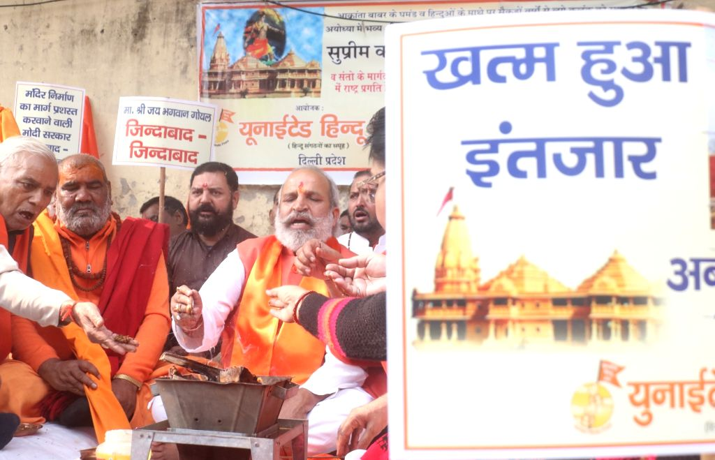 Members of United Hindu Front perform 'havan' to congratulate Prime Minister Narendra Modi on the commencement of the construction of Ram Temple in Ayodhya; in New Delhi on Dec 6, 2019. - Narendra Modi