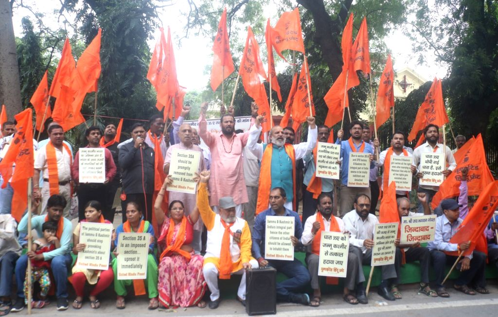 Members of United Hindu Front stage a demonstration to press for the removal of Article 35A from Jammu and Kashmir; in New Delhi on Sept 11, 2018. Article 35A, inserted in the Constitution ...