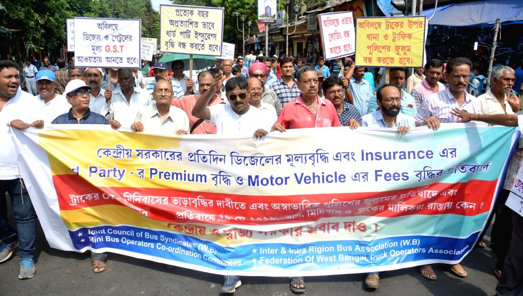 Members of various bus associations stage a demonstration against hike in the prices of petrol and diesel, in Kolkata on May 29, 2018.