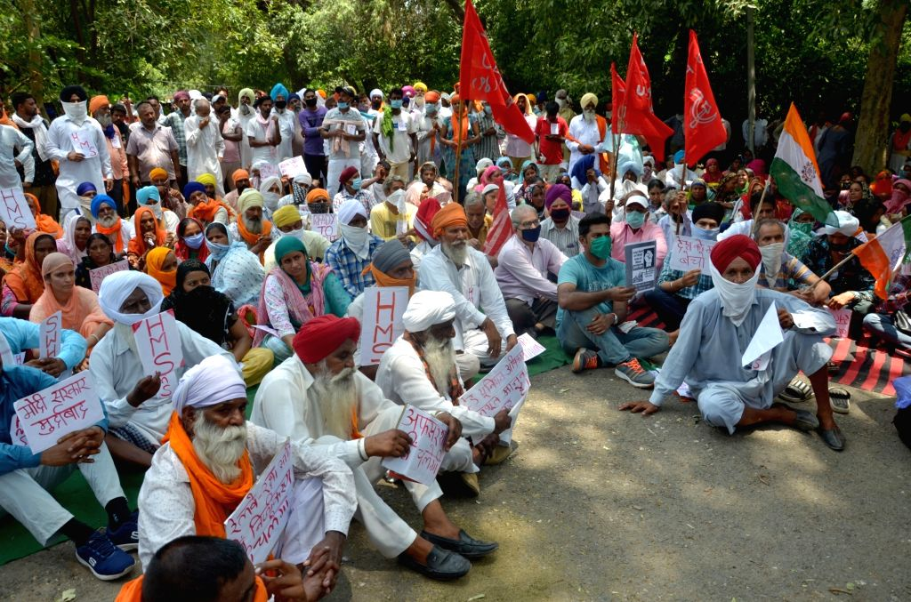 Members of various Trade Unions and daily wage labourers stage a demonstration against various policies of the Central Government while pressing for their certain demands, in Amritsar on ...
