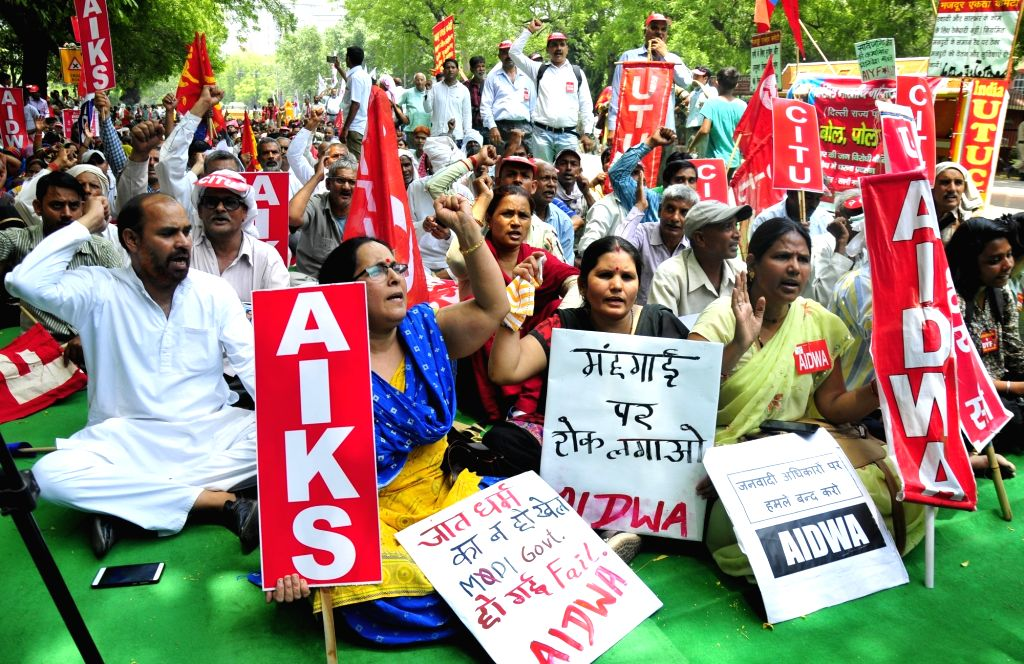 Members of various trade unions members stage a demonstration against National Democratic Alliance (NDA) Government in New Delhi, on May 23, 2018.