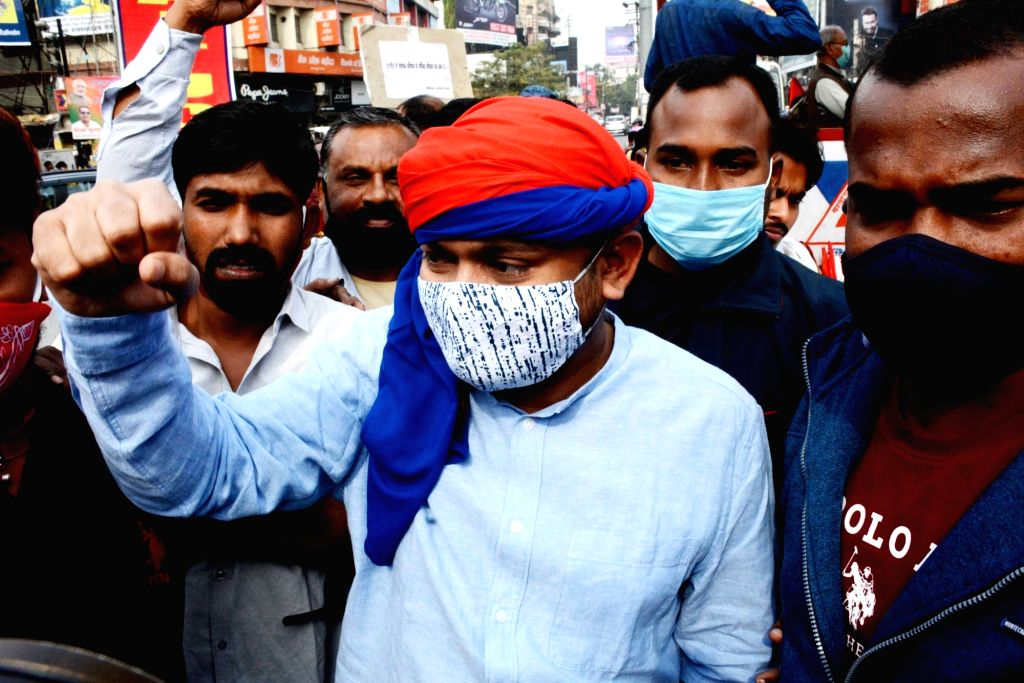 Members of various trade unions protest during the 24-hour nationwide trade union strike called by the central trade unions against the central government's new farm and labour laws, in Patna ...