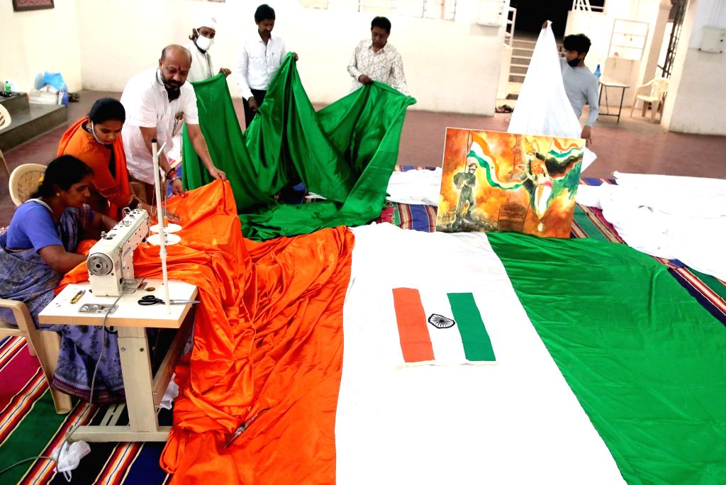 Members of Vastrabharana Charitable Trust busy stitching a 5400 sq feet long tricolour to be displayed during the upcoming Independence Day celebrations to salute the Indian Armed Forces, ...