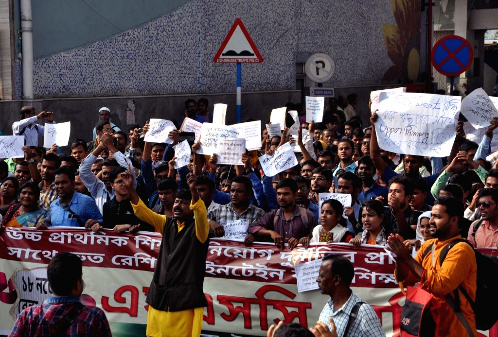 Members of West Bengal's Teachers Unity Open Forum  stage a demonstration against the state government over their various issues, in Kolkata on Nov 18, 2019.