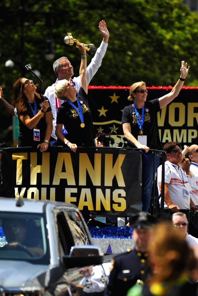 Members of women's soccer team of the United States and New York City Mayor Bill de Blasio(Back) take part in a celebration in New York, the United States, on July ...
