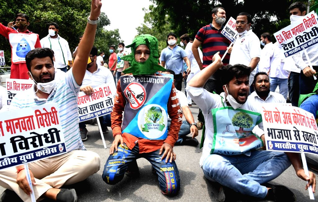 Members of Youth Congress stage a protest against the implementation of Environment Impact Assessment (EIA) draft, outside Union Environment Minister Prakash Javadekar's residence in New ... - Prakash Javadeka