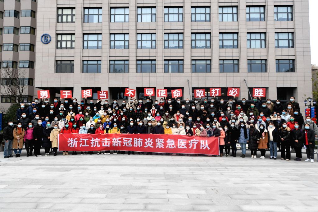 Members of Zhejiang's second medical team leaving for Wuhan of Hubei Province pose for a group photo before their departure in Hangzhou, east China's Zhejiang ...