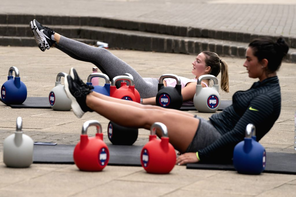 Members train outside a gym in a social distancing manner in Salford, near Manchester, Britain, on July 2, 2020.