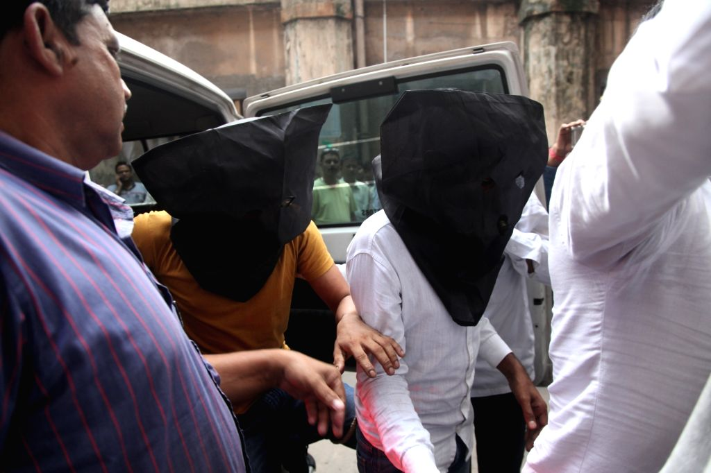 Men accused of hacking into the accounts of ATM users being taken to be produced before a court, in Kolkata on Aug 8, 2018.