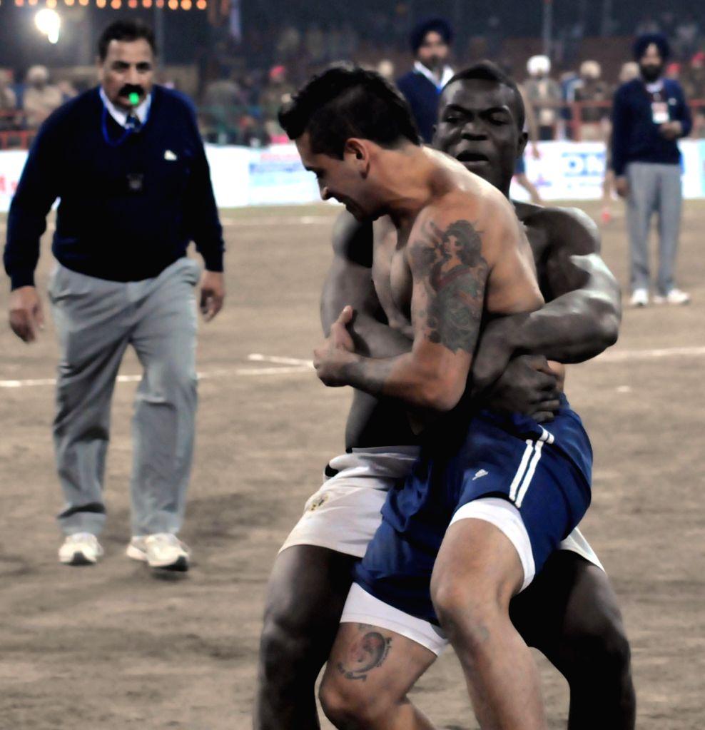 Men's Kabaddi match between Argentina and Kenya during the 4th Kabaddi World Cup at Guru Nanak Stadium in Amritsar on Dec.6, 2013.