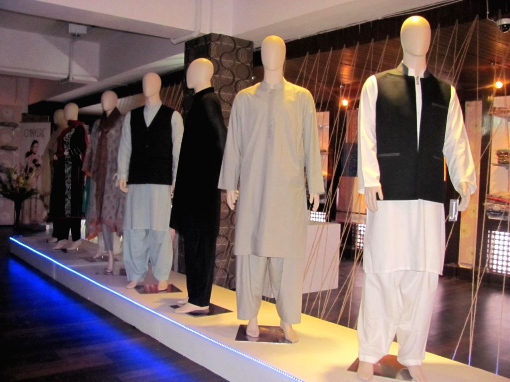 """Men's wear on disply at the """"Tradition of Finesse"""" exhibition of Pakistani designer wear that opened in Srinagar on June 12. (Photo: Raashid Bhat)"""