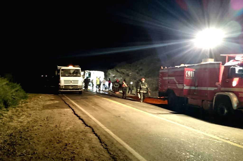 MENDOZA, June 26, 2017 - Members of emergency services work at the site of a collision near the city of San Rafael, province of Mendoza, Argentina, on June 26, 2017. At least 12 people were killed on ...
