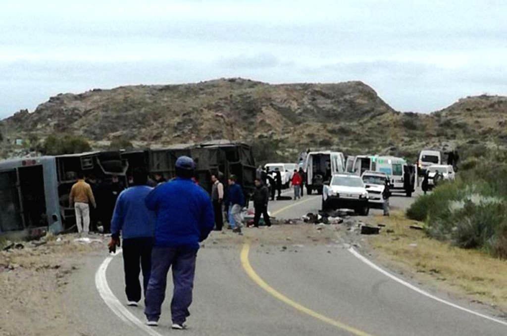 MENDOZA, June 26, 2017 - People gather at the site of a collision near the city of San Rafael, province of Mendoza, Argentina, on June 26, 2017. At least 12 people were killed on Sunday when a ...
