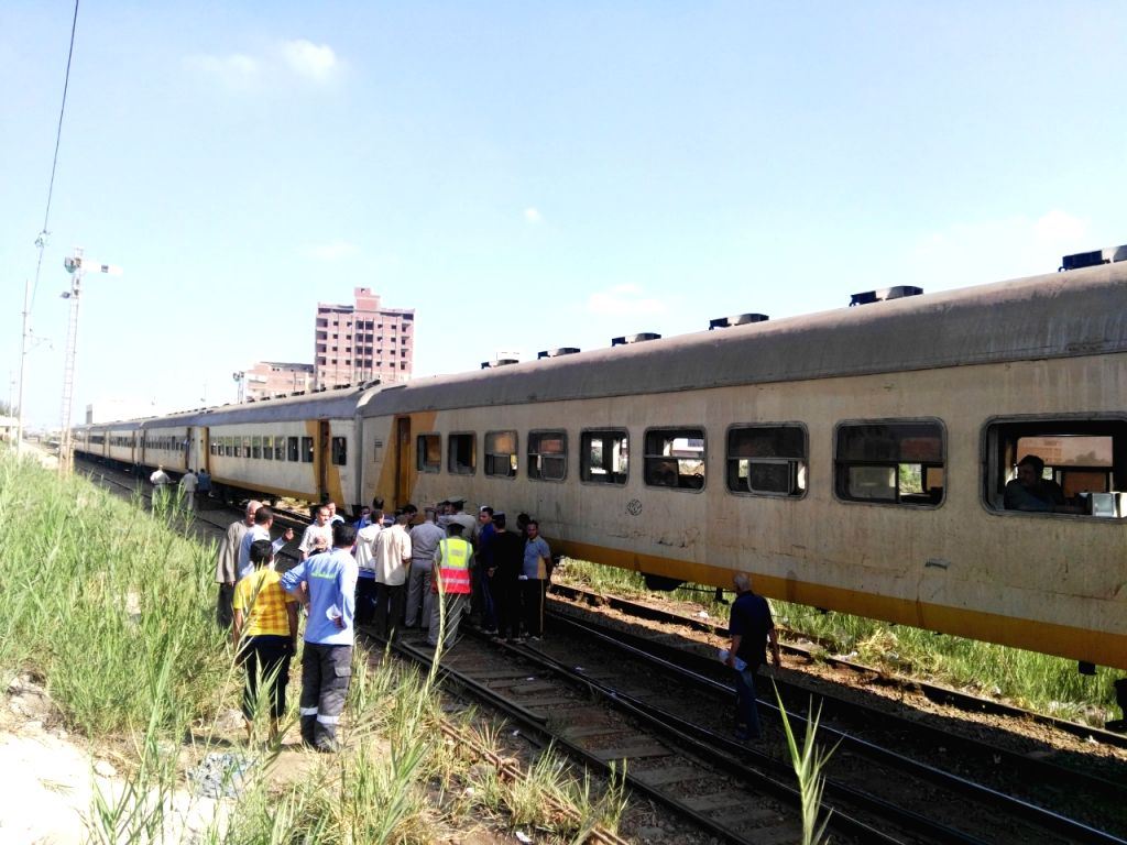 MENOUFIYA, Sept. 16, 2018 - People gather near the scene of a train accident in Menoufiya, Egypt, on Sept. 16, 2018. A train derailed on Sunday in Egypt's Nile Delta governorate of Menoufiya leaving ...