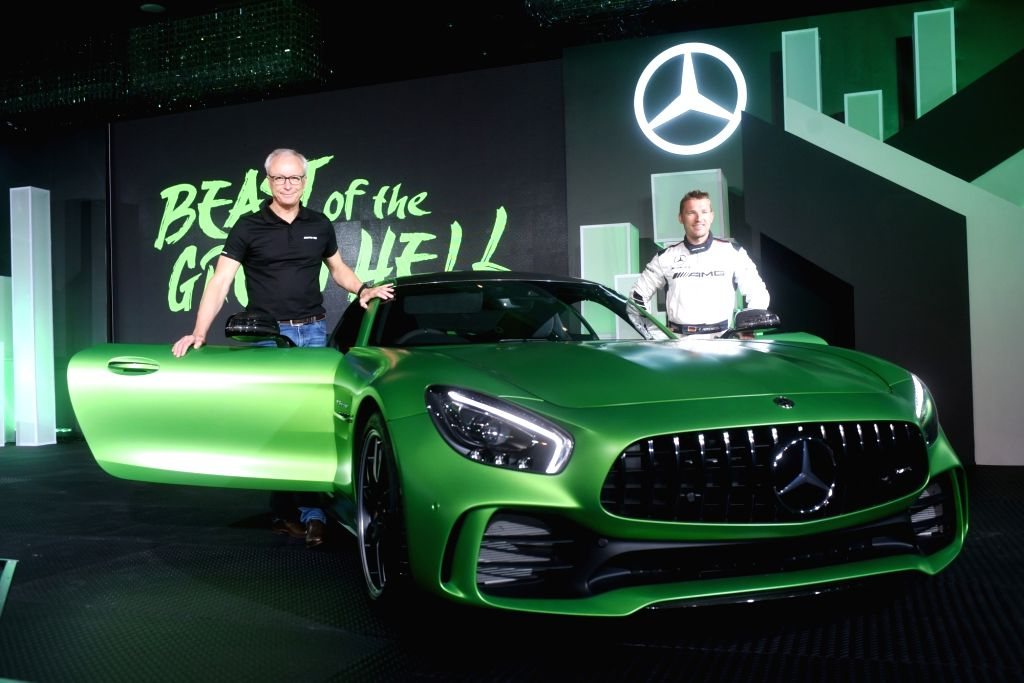 Mercedes-Benz India Managing Director and CEO Roland Folger along with German race car driver Christian Hohenadel at the launch of luxury car AMG GT R in New Delhi on Aug 21, 2017.