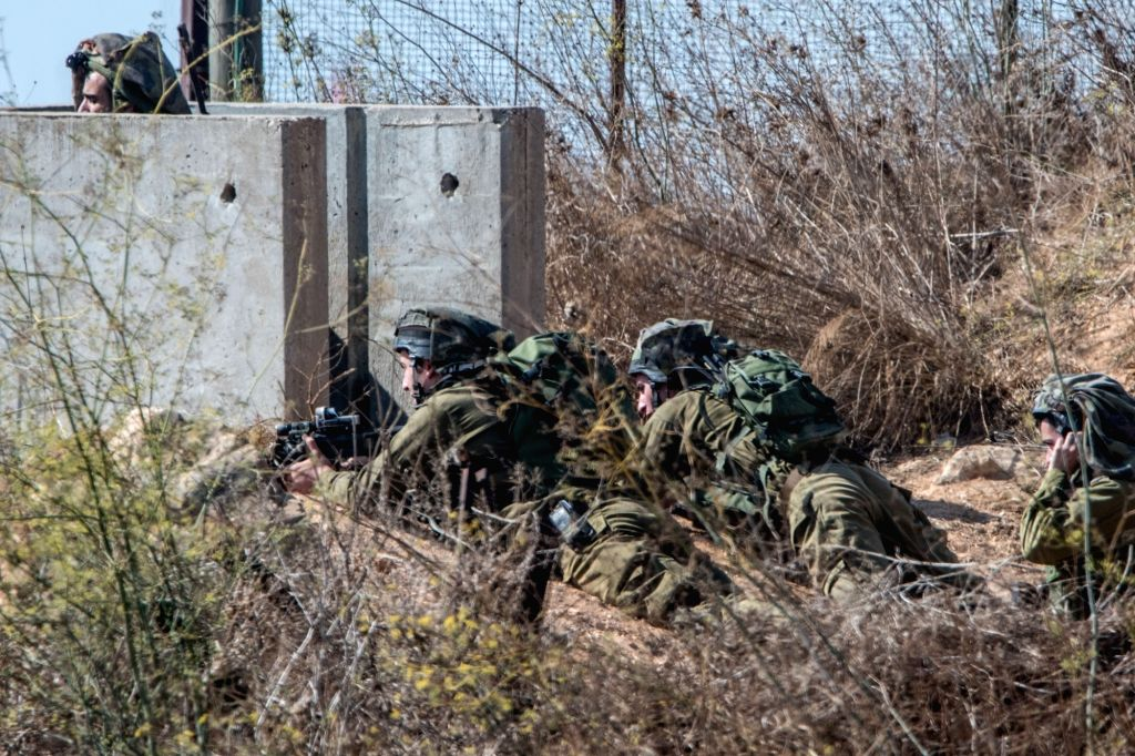 METULA, Oct. 26, 2016 - Israeli soldiers hold positions near the border with Lebanon in the town of Metula, Israel, Oct. 26, 2016. A man driving a car in Lebanon opened fire at Israeli forces near ...