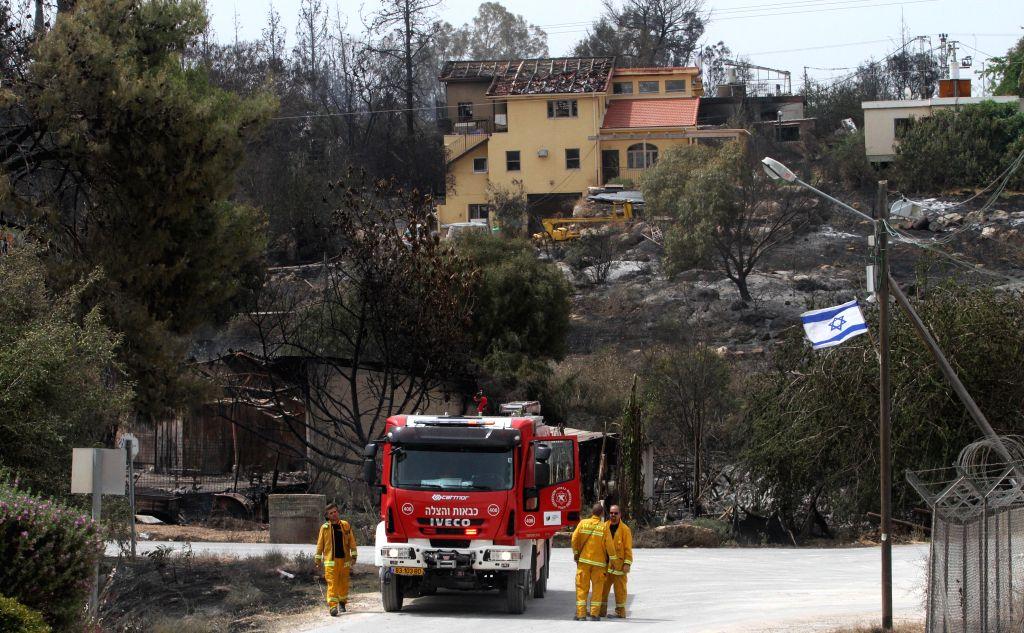 MEVO MODI'Firefighters check loss and damage following a fire amidst extreme heat wave in the village of Mevo Modi'im, Israel, May 24, 2019. The Israeli government said ... - Mevo Modi