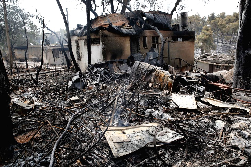 MEVO MODI'Photo taken on May 24, 2019 shows burnt-down houses following a fire amidst extreme heat wave in the village of Mevo Modi'im, Israel. The Israeli government ... - Mevo Modi